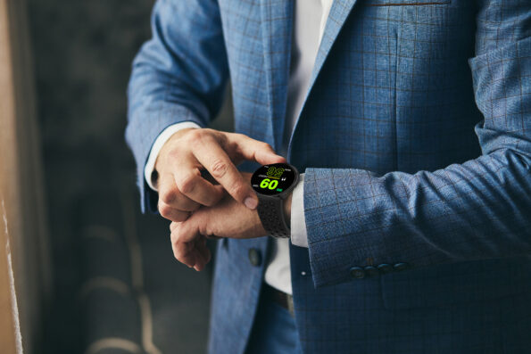businessman checking time on his wrist watch, man putting clock on hand,groom getting ready in the morning before wedding ceremony